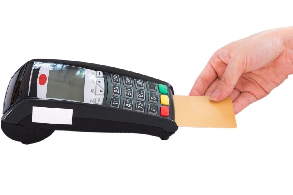 Woman-hand-swiping-a-credit-card-into-device