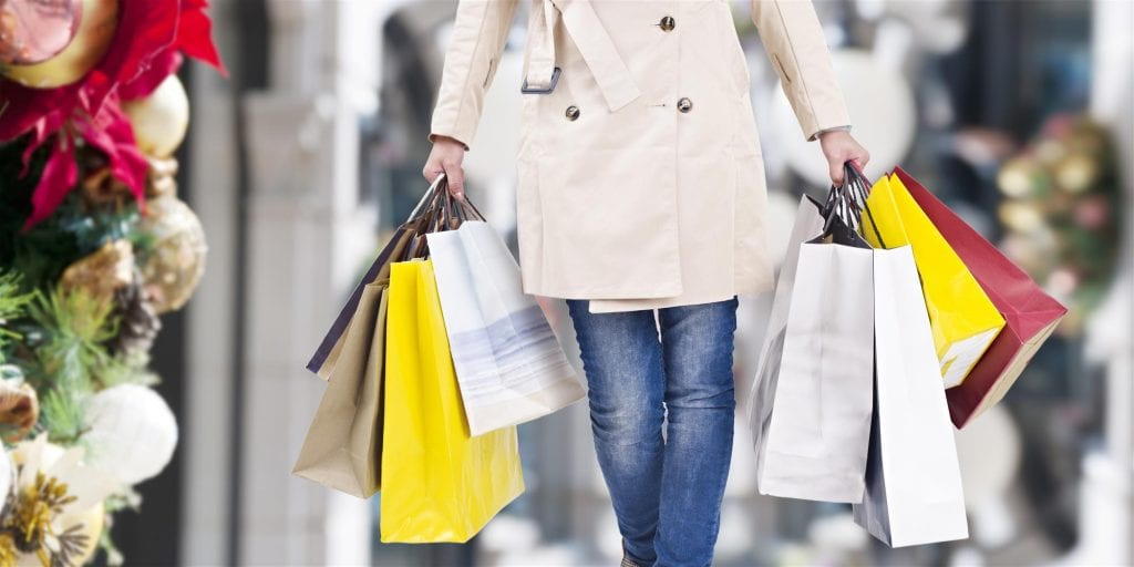 Woman-walking-with-shopping-bags