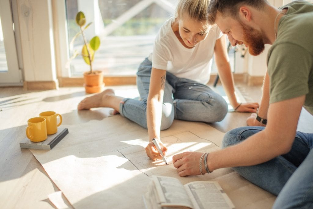 couple looking blueprints of they new house