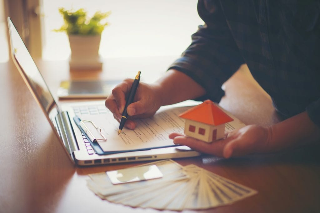 New Homeowner Signing A Contract Of House Sale
