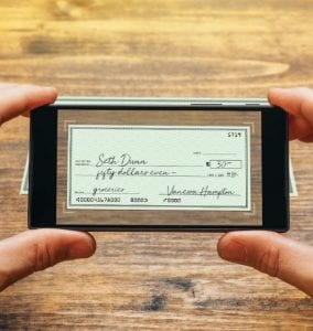 Taking photo of check with cell phone for remote deposit