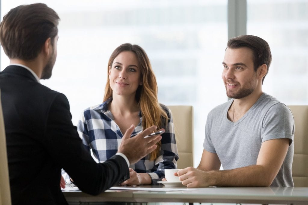 Couple customers consulting financial advisor making presentation offer